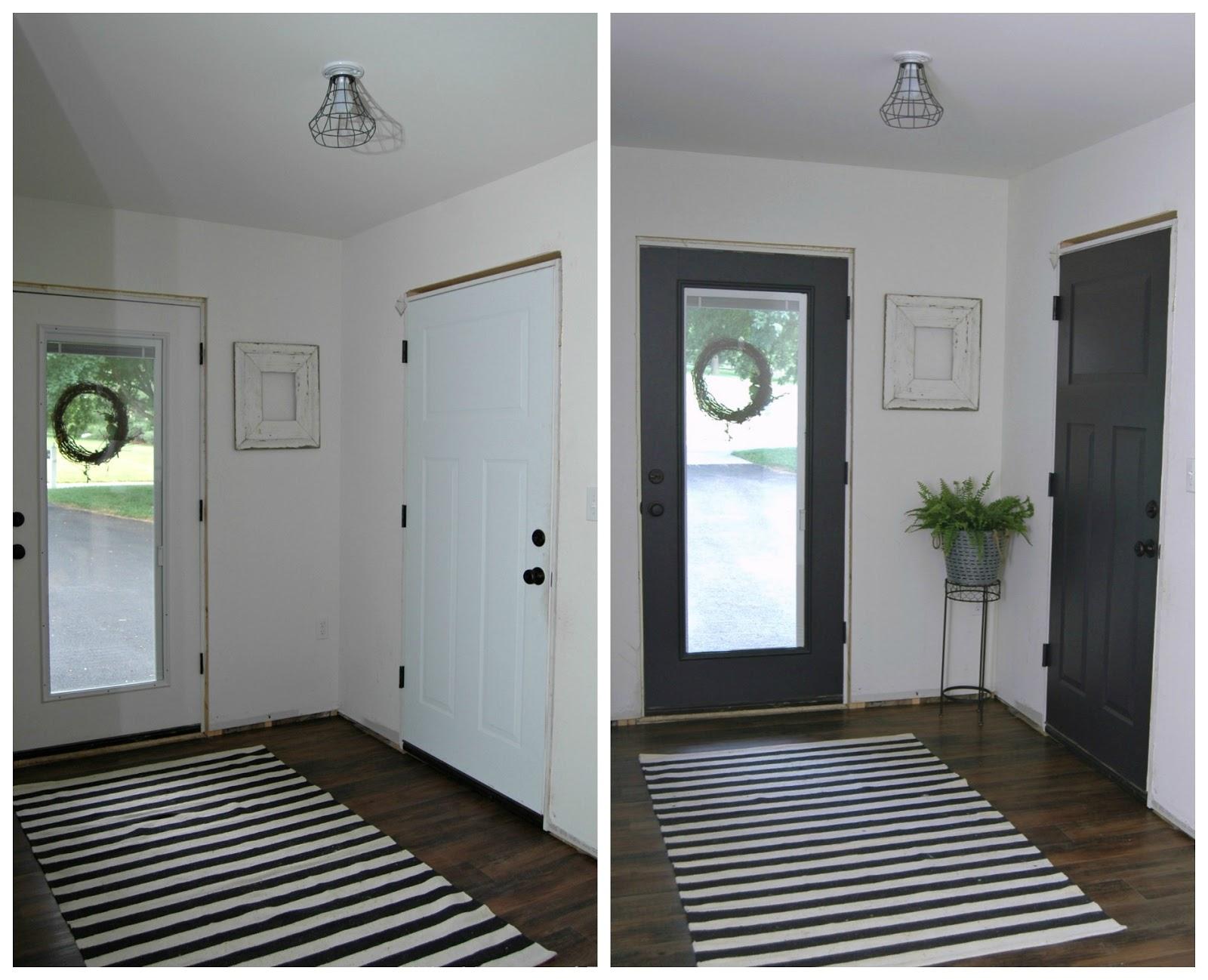 new foyer, black trim, updated front door, black closet door, interior design on a budget