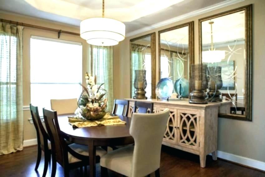 dining area with mirrors on wall an pendant lighting