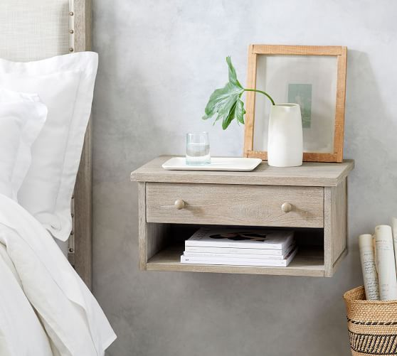 floating nightstand on wall next to bed